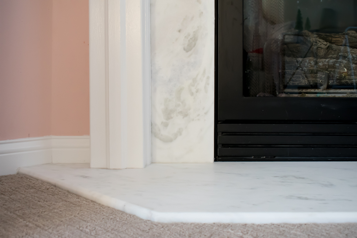 Before and After Honed Marble Fireplace Makeover